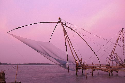 7-104-17  stock photo of India, Cochin, Chinese fishing nets at dusk