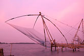 chinese fishing nets at sunset stock photography | India, Cochin, Chinese fishing nets at dusk, image id 7-104-17