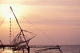 chinese fishing nets at sunset stock photography | India, Cochin, Chinese fishing nets at sunset, image id 7-108-23