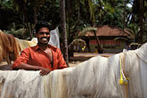 horizontal stock photography | India, Kerala, Fisherman with nets, image id 7-132-15