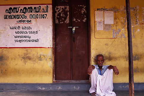 image 7-147-9 India, Kerala, Man on verandah, coastal village
