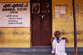 sleepy stock photography | India, Kerala, Man on verandah, coastal village, image id 7-147-9