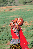rustic stock photography | India, Rajasthan, Woman with water, image id 7-367-7