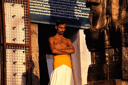 image 7-50-4 India, Trivandrum, Sri Padmanabhaswamy Temple, temple assistant