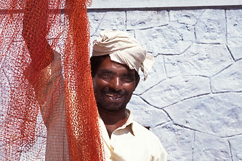 image 7-61-22 India, Trivandrum, Man with nets