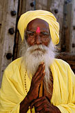 monks praying stock photography | India, Tamil Nadu, Saddhu with yellow robes, image id 7-74-2