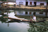coast stock photography | India, Kerala, Boatman, Alleppey canal, image id 7-88-36