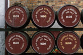 front view stock photography | Ireland, County Antrim, Bushmills Distillery, barrels, image id 4-751-3