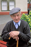 head covering stock photography | Ireland, County Cork, Skibbereen, Man with cane, image id 4-752-92