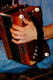 one hand stock photography | Ireland, County Clare, Doolin, Accordian player, image id 4-900-1057