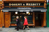 woman walking stock photography | Ireland, Dublin, Bohenny & Nesbitt pub, image id 4-900-18