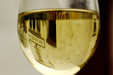 reflection stock photography | Ireland, County Antrim, Bushmills Inn, Glass of white wine, image id 4-900-580