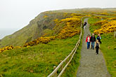 family on hillside stock photography | Ireland, County Antrim, North Antrim Cliff Path at Giant