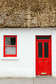 red stock photography | Ireland, County Galway, Ardrahan, Thatched cottage, image id 4-900-893