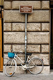 pavement stock photography | Italy, Rome, Bicycle with Sign, image id S4-500-3862