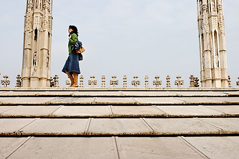 image S4-511-7202 Italy, Milan, Lady walking on Duomo rooftop