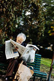 alone stock photography | Italy, Milan, Man reading the newspaper, image id S4-511-7399