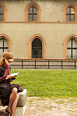 vertical stock photography | Italy, Milan, Woman Reading, Castello Sforzesco, image id S4-512-7416