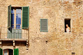 horizontal stock photography | Italy, Siena, Man in window, image id S4-521-7887
