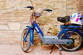 head covering stock photography | Italy, San Gimignano, Scooter, image id S4-528-8770
