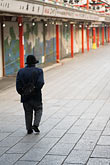 man walking down street stock photography | Japan, Tokyo, Asakusa, shopping street, Nakamise Dori, image id 5-850-1803