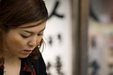 serious stock photography | Japan, Tokyo, Asakusa Kannon Temple, Young woman in prayer, image id 5-850-2091