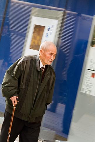 image 5-850-2657 Japan, Tokyo, Old man on sidewalk, Ginza