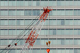 construction cranes stock photography | Japan, Tokyo, Crane and office building, image id 5-850-2777