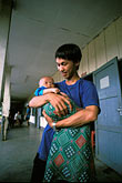 southeast asia stock photography | Laos, Phon Hong Hospital, Father and infant daughter, image id 8-560-33