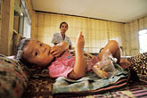 two girls stock photography | Laos, Phon Hong Hospital, Young patient, image id 8-560-7