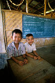 two people stock photography | Laos, Vientiane Province, School, Hinh Heub village, image id 8-630-16