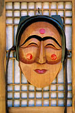 vertical stock photography | South Korea, Hahoe Village, Wooden mask, Pune, the Flirtatious Young Woman, image id 2-681-37