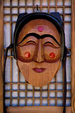 vertical stock photography | South Korea, Hahoe Village, Wooden mask, Pune the Flirtatious Young Woman, image id 2-681-45