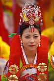 smiling woman stock photography | South Korea, Andong , Mask Dance Festival, Girl in traditional dress, image id 2-701-79