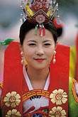 smiling woman stock photography | South Korea, Andong , Mask Dance Festival, Girl in traditional dress, image id 2-701-83