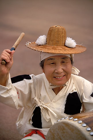 image 2-702-7 South Korea, Andong , Mask Dance Festival, Woman with drum