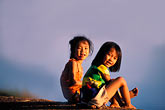 two people stock photography | Laos, Vientiane, Young girls on the bank of the Mekong, image id 8-550-1