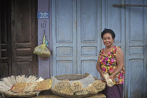 image 8-571-17 Laos, Vientiane Province, Woman selling sticks, Phon Hong