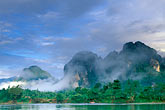 morning fog on hills stock photography | Laos, Vang Vieng, Morning mist on the river, image id 8-580-1