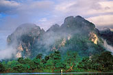 morning fog on hills stock photography | Laos, Vang Vieng, Morning mist on the river, image id 8-581-1