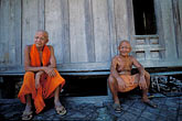two mature men stock photography | Laos, Luang Prabang, Buddhist Monks, image id 8-600-3