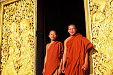 two teenagers stock photography | Laos, Luang Prabang, Monks, Wat Xieng Thong, image id 8-601-33