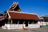 man on the plaza stock photography | Laos, Luang Prabang, Wat Mai, image id 8-603-47