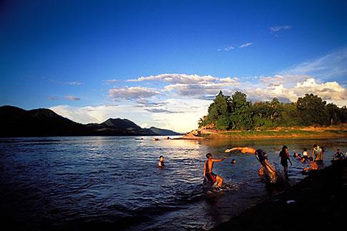 image 8-605-13 Laos, Luang Prabang, Bathing in the Mekong at sunset