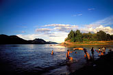 sunset at beach stock photography | Laos, Luang Prabang, Bathing in the Mekong at sunset, image id 8-605-13
