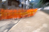 motion stock photography | Laos, Luang Prabang, Monks walking for alms, image id S3-153-1