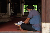sacred stock photography | Malaysia, Malacca, Man reading the Koran, Kampong Kling Mosque, image id 7-571-33