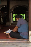 sacred stock photography | Malaysia, Malacca, Man reading the Koran, Kampong Kling Mosque, image id 7-571-36