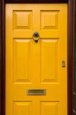 vertical stock photography | England, Saddleworth, Dobcross Village, yellow door, image id 7-690-7088