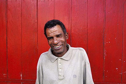 image 9-201-56 Mauritius, Man and red wall, Poste de Flacq